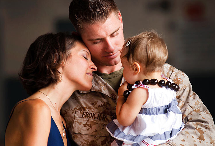 Marine family in an embrace