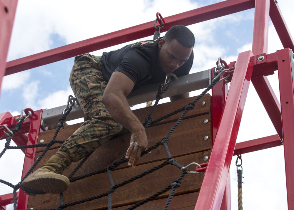 Marine going over obstacle wall