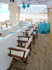 Outdoor reception setting with table and chairs