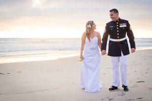 Marine and bride walking on beach