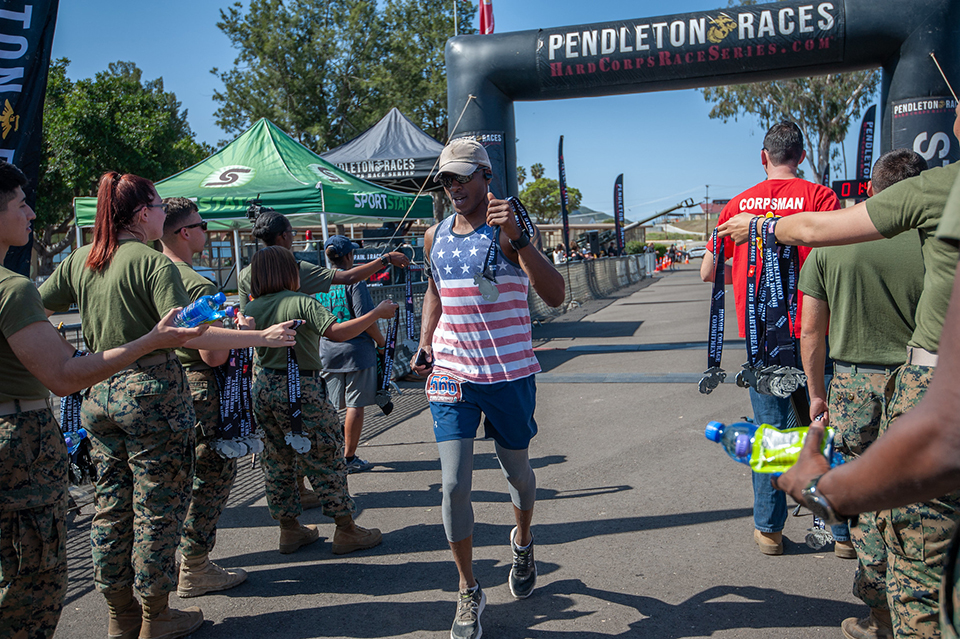 Man crosses finish line during a Race Series event