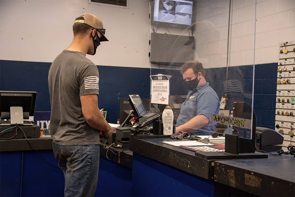 auto skills store patron checking out with cashier