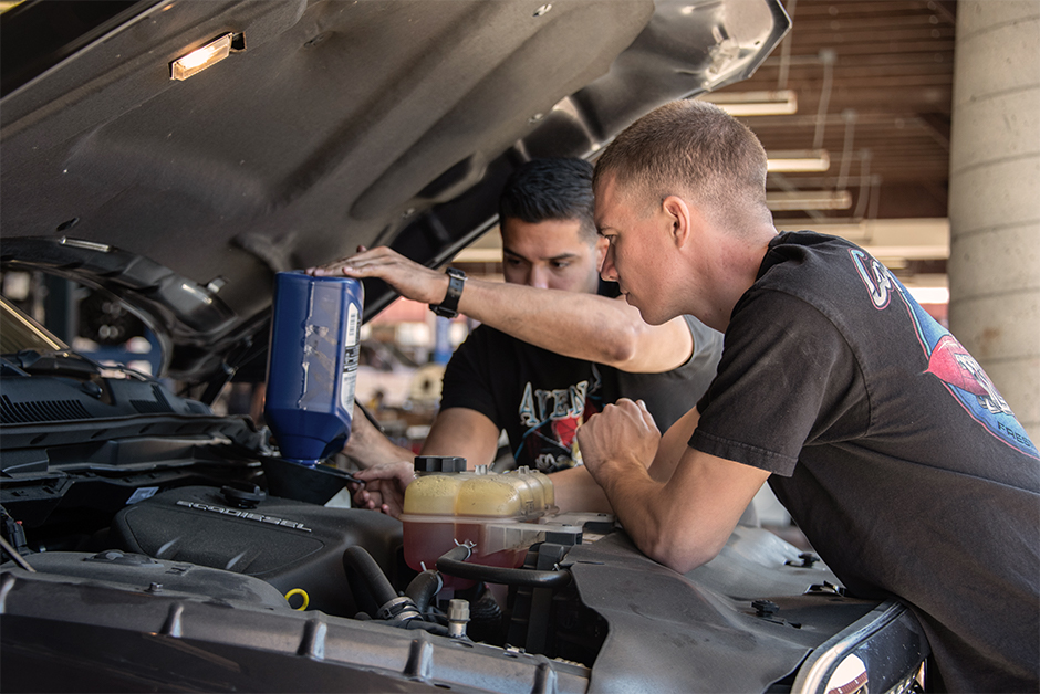 marines changing oil at auto skills
