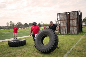Marine lifts tractor tire on HITT course