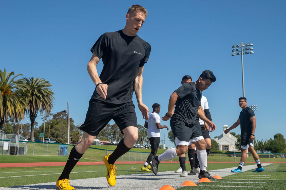 Group of Marines training on the field for soccer.