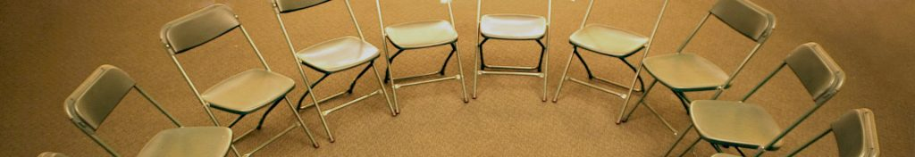 circle of empty foldable chairs